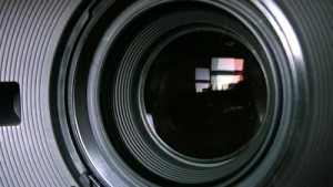 stock-footage-camera-zoom-closeup-shot-of-professional-video-camera-with-its-lens-zooming-in-and-out-canon-xh
